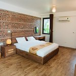 Standard double room. Rustic decoration style with brick wall, wooden floor, and all amenities are naturally made.