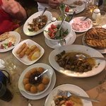 Before and after👍 Fried pork, Saganaki, cheese balls, Greek salad, fried chicken, Taramosalata and delicious pita. Wonderful staff. Family style from kitchen to waiter, best place I Ixia!