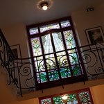 Beautiful stained glass windows in the hotel's staircase