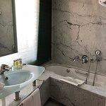 Sink and bathtub in marble washroom