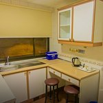 Kitchen comes with microwave, fridge & kettle