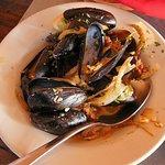 Amazingly tasty, succulent mussels. MEJILLÓNES Y CHORIZO PEI mussels*, crumbled chorizo*, fennel
