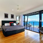 Master bedroom with private balcony and amazing views.