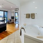 Master bedroom with ensuite including large bath