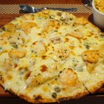 Sea bass and prawn pizza with bechamel sauce