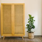 A nice wardrobe which is made of rattan