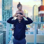 Daddy put me on your shoulders so I can see Toronto, so he did from the rooftop.