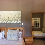 Garden Trail Cottage, second bedroom with a king bed and extra single bed.