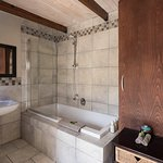 Garden Trail Cottage, master bedroom bath with a king bed and extra single bed.