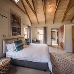 Garden Trail Cottage, master bedroom with a king bed and single sofa bed.