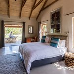 Garden Trail Cottage, master bedroom with a king bed and extra single bed.