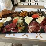 Meats, cheeses and few vegetables platter