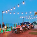 Patio seating by the bay
