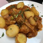 Tender Pork stew with potatoes and olives