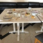 Typical nasty table in dining room. Stink in dining room is everywhere