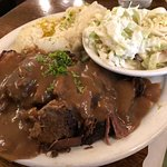 The large delicious portion pot roast with a side of creamy coleslaw