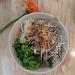 Lemongrass slice beef mixed with salad and rice noodle