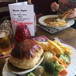 Steak and Stilton Pie with Mushroom Stroganoff in the background.