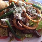 Black and blue salad; it is huge and there is plenty of steak.