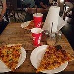 صورة فوتوغرافية لـ Pizza Slice