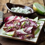 Pear & Endive Salad - seasonal pears, red and gold endive with blue cheese, candied bacon and pear vinaigrette.