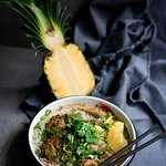Season fish and meat soup Bun ca with rice noodles, carp, tomato, pineapple, dill and coriander