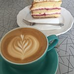 Cafe latte and victoria sponge
