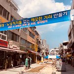 Leave the main gate of Osan, veer right and he restaurant is off this street on the left side.