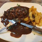 Fillet Steak with mushroom and brandy sauce and sauté potatoes.