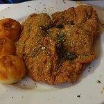 Fried turkey fillet with pumpkin seeds.