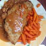 potato pancake with goulash filling, goulash sauce and carrots