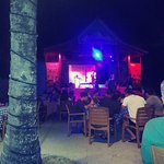 Country and Western night from the edge of the pool. St Lucian Cowboy on stage.