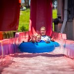 Father and son on water slide.