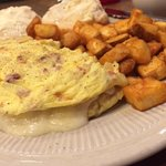 Bacon, swiss cheese and onion omelet with home fries.
