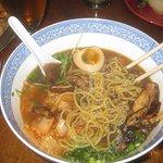 Noodle Bowl with noodles, pea shoots, scallions, soy marinated egg, kimchi, shiitake mushrooms.
