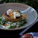 Salmon & smoked haddock fishcake: homemade fishcake with wilted spinach, kale & nutmeg in a cheddar cream sauce, free-range poached egg, toasted almonds