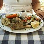Lamb shank with sald, potatoe, onion, carrot, mint sauce and gravy.