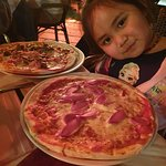 Our little princess loving her own pizza! She devoured three-quarters of it by the end!