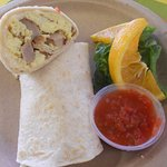 breakfast burrito with egg, sausage and cheese with salsa and a small green salad