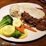 Greasy chicken fried steak, but good vegetables and potatoes.