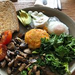 Real Food Breakfast Two eggs, (poached or fried), button mushrooms, wilted kale, vine tomato, ve
