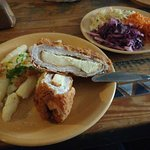 Schnitzel with mountain cheese, kopytka and 3 types of salads