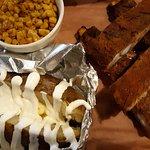 ribs, baked potato, corn