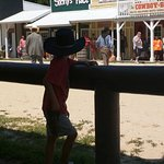 """Son watching the shooting at the """"OK Corral""""."""