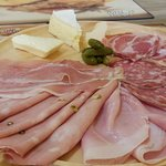 The our platter of Imported Italian cold cuts and cheeses