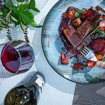 Duck breast rosé, season's vegatables, local red wine