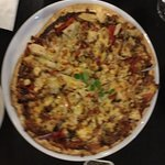 The pizza was thin crusty and tasty. We shared bbq chickencap