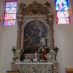 A few stained glass windows and one of the side altars