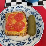 Toasted Cheese with tomato on fresh Oat Bread w pickle! It was very tasty and filling.