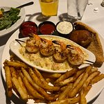 Seafood platter. Lobster mac-n-cheese, fried stuffed crab, catfish filet, shimp skewer and fries